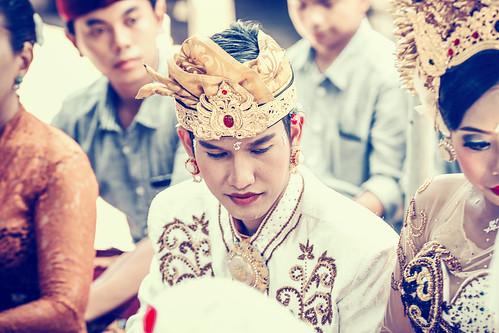 BALI, INDONESIA - APRIL 13, 2018: People on balinese wedding ceremony. Traditional wedding.