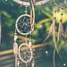 Dreamcatcher sunset , boho chic, ethnic amulet,symbol, tropical background.