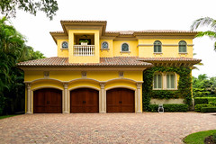 Spanish Style Triple Wood Door (Precision Door Service) Tags: home house building landscaping driveway front trees palm sky tiles shrubs hedgespanish florida tropic lush