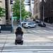 Electric wheelchair in crosswalk downtown
