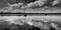 Clouds (hjuengst) Tags: clouds wolken reflection reflektionen spiegelung boote boat sailboat segelboot blackandwhite schwarzweis wörthsee lake see bavaria bayern beautyofwater