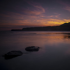 Fleeting (Nobbinumnut) Tags: dorset kimmeridgebay sunset reflections sea longexposure