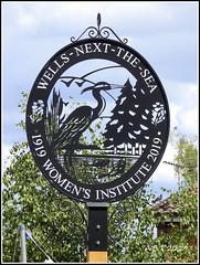 Wells-Next-The-Sea. 'Women's Institute' Village Sign (Alan B Thompson) Tags: 2019 june sign lumix fz82 picassa