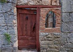 Door and the Madonna (Donard850) Tags: france door window statue madonna wall st antonin noble val stantoninnobleval ironbars medieval house fujixt20
