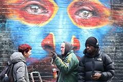 """I think its just down there...."" (markwilkins64) Tags: art shoreditch bricklane london dalegrimshaw streetartist streetart streetphotography street candid juxtaposition markwilkins eastlondon eyes face headphones hat spraycanister spraycan paint artwork streetscene urban paintspray spraypaint"