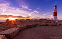 Two light sources (_Jon Benham_) Tags: portland lighthouse sunset dorset uk lightrays landscape