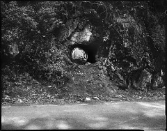 Cave blocked with a boulder on Sutter Creek Volcano road (dwilliamjohnson) Tags: caffenol calumet california landscape blackandwhite bw bergger mine cave road