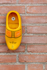 Wall-wear (A Different Perspective) Tags: delft holland netherlands brick clog detail giant mural ornament shoe wall yellow