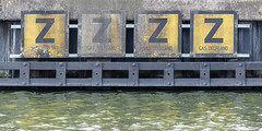 Sleepy river (A Different Perspective) Tags: 4 delft holland netherlands canal detail mural sign text wall water yellow z