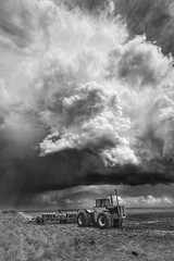 Big Clouds, big tractor (journey ej) Tags: