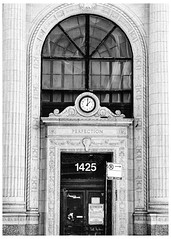 Perfection (swanksalot) Tags: blackandwhite bw tweeted door doorway publicnotice perfection arch diversey empty window explored explore perfect