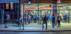 Red Line Blues (Wes Iversen) Tags: chicago chicagocubs el elevated fencefriday hff illinois lakeview nikkor18300mm redline wrigleyville crowds doors fans fences glass men night nightgame people sidewalks signs stairs streets women