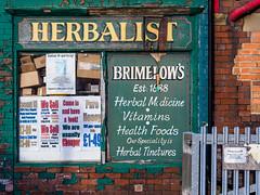 Dewsbury 018 (Peter.Bartlett) Tags: kirklees facade urban shopfront window uk m43 microfourthirds wall shopwindow olympuspenf sign unitedkingdom westyorkshire poster dewsbury england