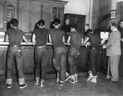 Juvenile Delinquents Arrested (jericl cat) Tags: newyork city manhattan police arrest juvenile delinquents delinquent undesirables kids youth latino mexican 1954 1950s puertorican gang station booked booking arrested dungaree jeans uniform clothes sneakers westsidestory timessquare youths vintage photo history