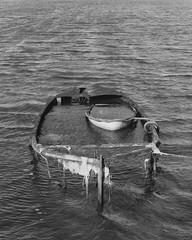 Boat Melancholia I (Attila Pasek (Albums!)) Tags: camera blackandwhite bw film water mediumformat boat junk ship delta 120film 400 analogue wreck ilford wreckage awash bronicasqa poolebay