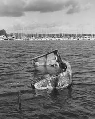Boat Melancholia II (Attila Pasek (Albums!)) Tags: wreck bronicasqa mediumformat water bw junk analogue ship wreckage awash delta 400 camera blackandwhite boat 120film ilford film poolebay