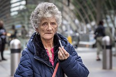 A Cigarette (Leanne Boulton) Tags: urban street candid portrait portraiture streetphotography candidstreetphotography candidportrait streetportrait eyecontact candideyecontact streetlife old elderly woman female lady face eyes expression emotion mood smoke smoker smoking cigarette gesture tone texture detail depthoffield bokeh naturallight outdoor light shade city scene human life living humanity society culture lifestyle people canon canon5dmkiii 70mm ef2470mmf28liiusm color colour glasgow scotland uk