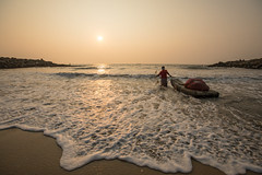 Fisherman, Indian Ocean (Geraint Rowland Photography) Tags: ocean oceanlife fishing afishermanenterstheoceanatsunsetinmarari kerala india portraitsofindia swell tide incomingtide wideangle canoe sunset shore beach downbythesea whitewater wwwgeraintrowlandcouk