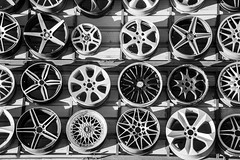 wheels on the wall (Pejasar) Tags: wheels rims spokes blackandwhite bw metal contrast geometric