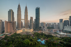 Cityscape of Kuala Lumpur Panorama at sunrise. Panoramic image of skyscraper at Kuala Lumpur, Malaysia skyline at dawn. (MongkolChuewong) Tags: architecture asia asian blue building business capital center city cityscape destination district downtown dusk evening famous home house kl klcc kuala landmark landscape lumpur malaysia malaysian modern night office panoramic petronas place reflection scene sky skyline skyscraper summer sunrise sunset technology tower towers travel traveler traveller twilight twin urban view happyplanet asiafavorites