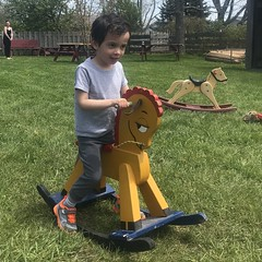Ezra on a rocking horse (brownpau) Tags: canada novascotia halifax coleharbour coleharbourheritagefarmmuseum iphone7 ezraordo ezra