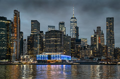 Like a dream on a winter dusk (ricardocarmonafdez) Tags: newyork manhattan cityscape ciudad city skyline skyscrapers rascacielos winterday cielo sky nubes clouds dramatic lights lighting shadows brillos shines reflejos reflections nikon d850 24120f4gvr highiso lowlight color buildings river hudson