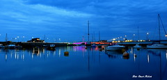 Evening Blues (Peter.S.Roberts) Tags: interesting eveningblues evening nightshot bluehour longexposure rhyl rhylharbour river water sea bridge boats yachts boating irishsea estuary details pov dof pontyddraig reflections colours harbor inlet seascape lights lighting blues powerboats speedboats masts moorings buoys harbourlights colors streetlights fishingboats outdoor night footbridge illuminated 1062019 flickr petersroberts nikond7200 wideangle sigmaf35 buildings shacks harbourmaster nature quiet serene peaceful tranquil relaxing cool relaxed perspective placid sky clouds photographyvision fotografíavisión