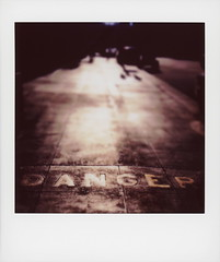 Danger Street (tobysx70) Tags: fujifilm fuji instax share sp3 square instant film smartphone ipad mini wifi printer danger street south main st dtla downtown los angeles la california ca warning sign sidewalk pavement light shadow sepia bokeh toby hancock photography
