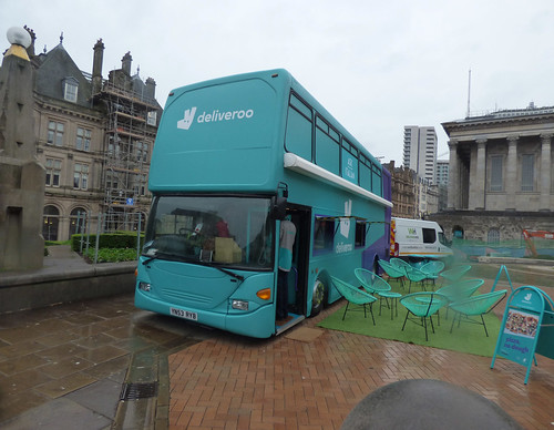 Deliveroo bus in the rain in Victoria Square