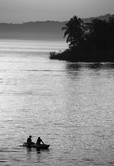 Guatemalan Kayakers (peterkelly) Tags: digital bw northamerica canon 6d guatemala flores lakepeténitzá water kayak kayakers kayaker paddling centralamerica island shoreline shore evening sunset