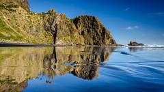 Wigmore Bay Reflections (Stefan Marks) Tags: tasmansea wigmorebay bay beach cloud nature ocean outdoor reflection rock sky aucklandwaitakere northisland newzealand