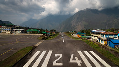 Lukla Airport (Neha & Chittaranjan Desai) Tags: lukla travel nepal camp sky mountains clouds trekking trek airplane landscape airport landing everest base himalayas