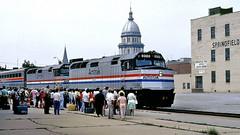 "Amtrak ""Inter-American"" @ Springfield IL (1981) (hardhatMAK) Tags: amtk377 amtk374 amtrak emdf40ph southbound interamerican 8161981 springfieldil scannedslide kodachrome64 statecapitol passengers stationplatform buildings superlinercars"