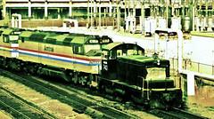 Three Generations of Amtrak Power (Chicago IL 1981) (hardhatMAK) Tags: amtk743 amtk617 amtrak rooseveltroad chicagoil 2211981 scannedslide kodachrome64 1941emdsw1 1974emdsdp40f 1979emdf40ph amtk301