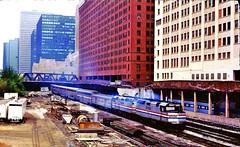 "Amtrak ""Empire Builder"" @  Lake & Canal Chicago IL (1983) (hardhatMAK) Tags: amtk335 amtrak emsf40ph empirebuilder westbound lakeandcanal chiacgoil 5281983 scannedslide kodachrome64 superlinercars buildings trussbridge privatecar"