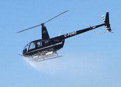 Helicopter Spraying Shading Agent on Greenhouses (Bruce Bolin) Tags: