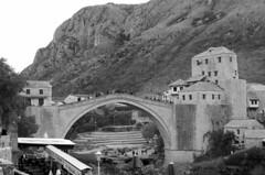 Mostar (sfryers) Tags: starimost oldbridge oldtown historic reconstructed ottoman stone arch bridge islamic architecture river neretva mountains valley bosnia herzegovina bosnaihercegovina smc pentaxfa 35mm 12 monochrome