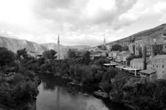 Neretva (sfryers) Tags: oldtown historic reconstructed city islamic architecture mosque minaret river neretva mountains valley bosnia herzegovina bosnaihercegovina smc pentaxfa 15mm 14 limited monochrome