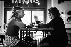 Table Talk (gwpics) Tags: female woman women england cafe french mettricks greatbritain streetphotography mono people southampton blackandwhite uk english analog analogue britain coffeehouse editorial everydaylife film hampshire hants lady leica lifestyle monochrome person socialcomment socialdocumentary society streetscene streetphotos streetpics unitedkingdom bw blackwhite street streetlife