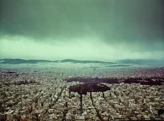 Rain over Athens, Greece. (wojszyca) Tags: fuji gsw680iii 6x8 120 mediumformat fujinon sw 65mm fujichrome astia 100f rap expired outdated epson v800 city urban cityscape skyline clouds rain mountains athens greece