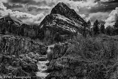 Rocky (Ry Meehan) Tags: bw blackandwhite monochrome mountain river trees glaciernationalpark nationalpark montana usa texture beauty clouds rocks water