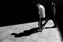 The Hunchback 4 (Mattiii photo) Tags: street streetphotography streetphoto streetshot streetphotographer streets streetitalia streetph streetshots streetphotograph streetlife streetparma streetimage streephotographer streetminimal strada streethsot streetpassioneadwards urbanphotography urban urbanphoto urbanshot blackandwhite blackandwhitephotography blackandwhitephoto blackandwhiteshot blackandwhitephotographer blackwhite biancoenero bnw biancoeneroforever bnwphotography bnwphoto biancoenerofoto bnwshot dark light hunchback gobbo one two person boy man men monochromatic monochrome parma italia italy italianstreetphotography italianstreetphotographer italian triangular shadow shadows shot