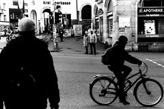 In-between (Nikon F80) (stefankamert) Tags: inbetween people crossing street tübingen bicycle film analog grain nikon f80 nikonf80 voigtländer ultron ilford hp5 bw noir noiretblanc blackandwhite blackwhite