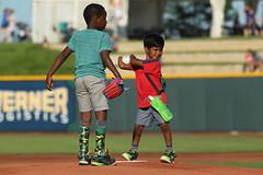 Small child, awesome first pitch (Minda Haas Kuhlmann) Tags: sports baseball milb minorleaguebaseball pacificcoastleague omahastormchasers nebraska omaha papillion sarpycounty outdoors fans onfieldpromotions