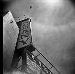 Albany Cinema, Albany, CA, (Timothy Lewis Jr.) Tags: holga trixpushed2x orangefilter holga120n holgaphotos analoguefilm architecture analogue blackandwhite blackandwhitefilm bw building kodaktrix trixpushed2stops trix120