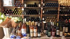 В магазине (unicorn7unicorn) Tags: цветок бутылка листья магазин вино wah
