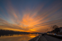 Evening Time (Slav.Burn) Tags: toruń vistula dusk sunset sky skycolors poland pentaxart tamron1750 boulevard people evening