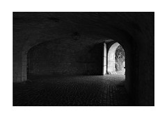 Attraction (Thomas Listl) Tags: thomaslistl blackandwhite biancoenegro noiretblanc monochrome cave tunnel light mood dark fuji fujixt3 av af würzburg door entrance exit passage mysterious mystery