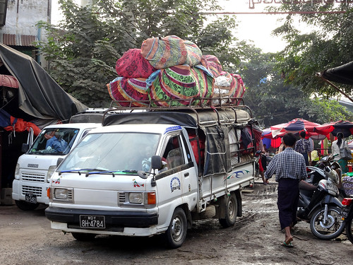 Trucks loaded up are a common sight at the Flower Market in Mandalay