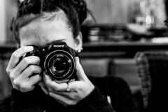 The photographer focuses the lens (nicolas-7878) Tags: children child enfant young cinematic nikon nikond5500 noiretblanc nb blackwhite bw kid main hand camera portrait photographe photographer focus portraiture portait sony she sonyhx200v girl daughter teenager